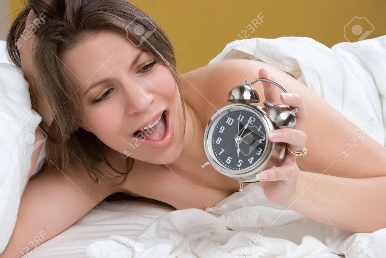Girl Waking up to Alarm Clock Stock Photo - 5668618