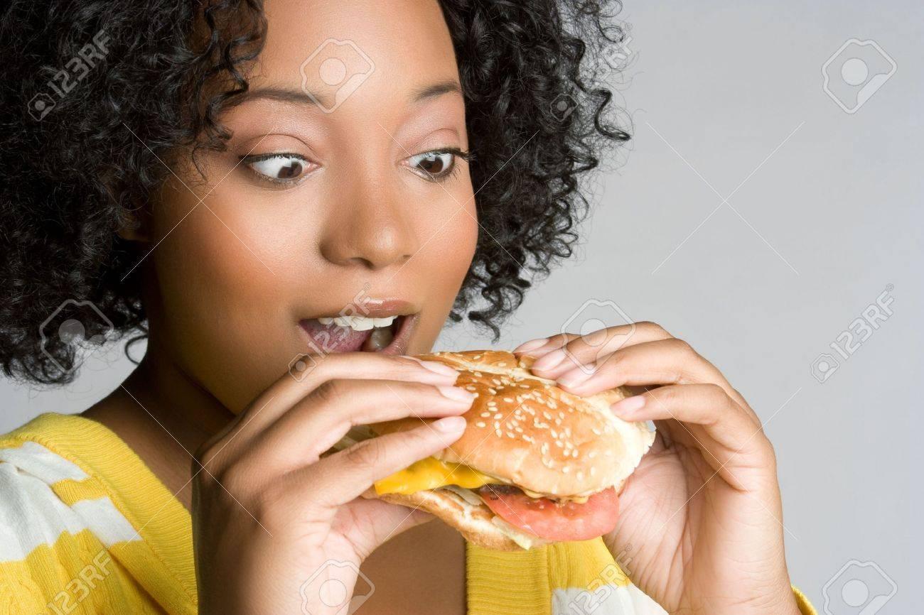Woman Eating Cheeseburger Stock Photo - 6059247