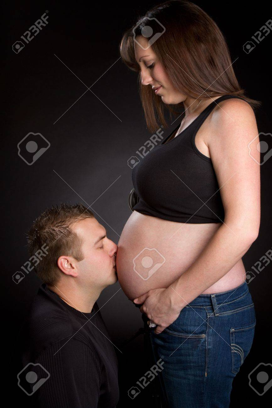 Daddy Kissing Pregnant Belly Stock Photo - 6307090