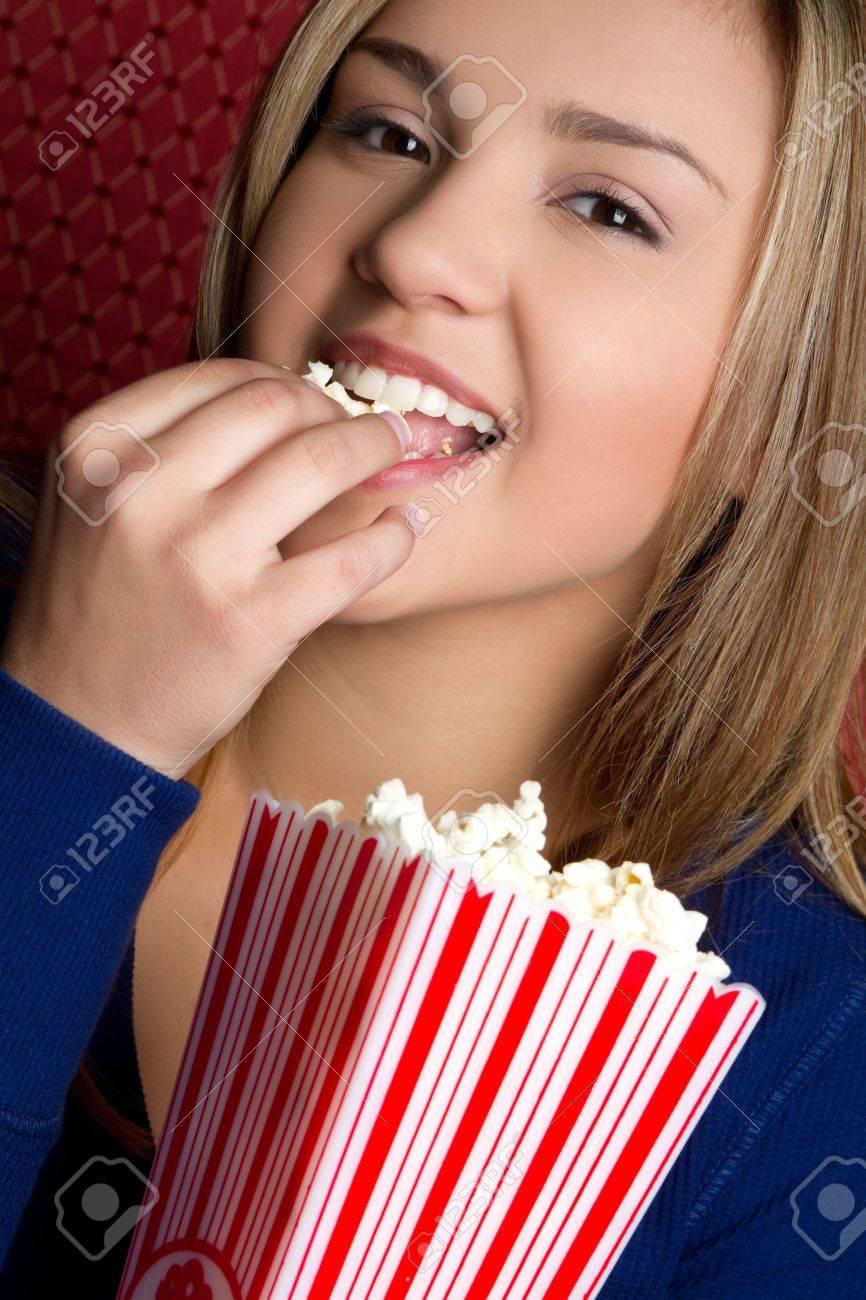 Girl Eating Popcorn Stock Photo - 6763155