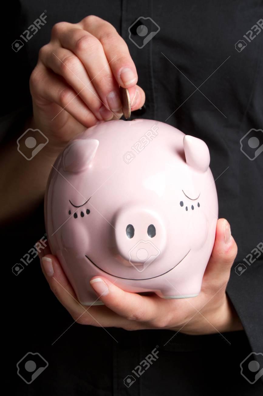 Coin in Piggy Bank Stock Photo - 6789612