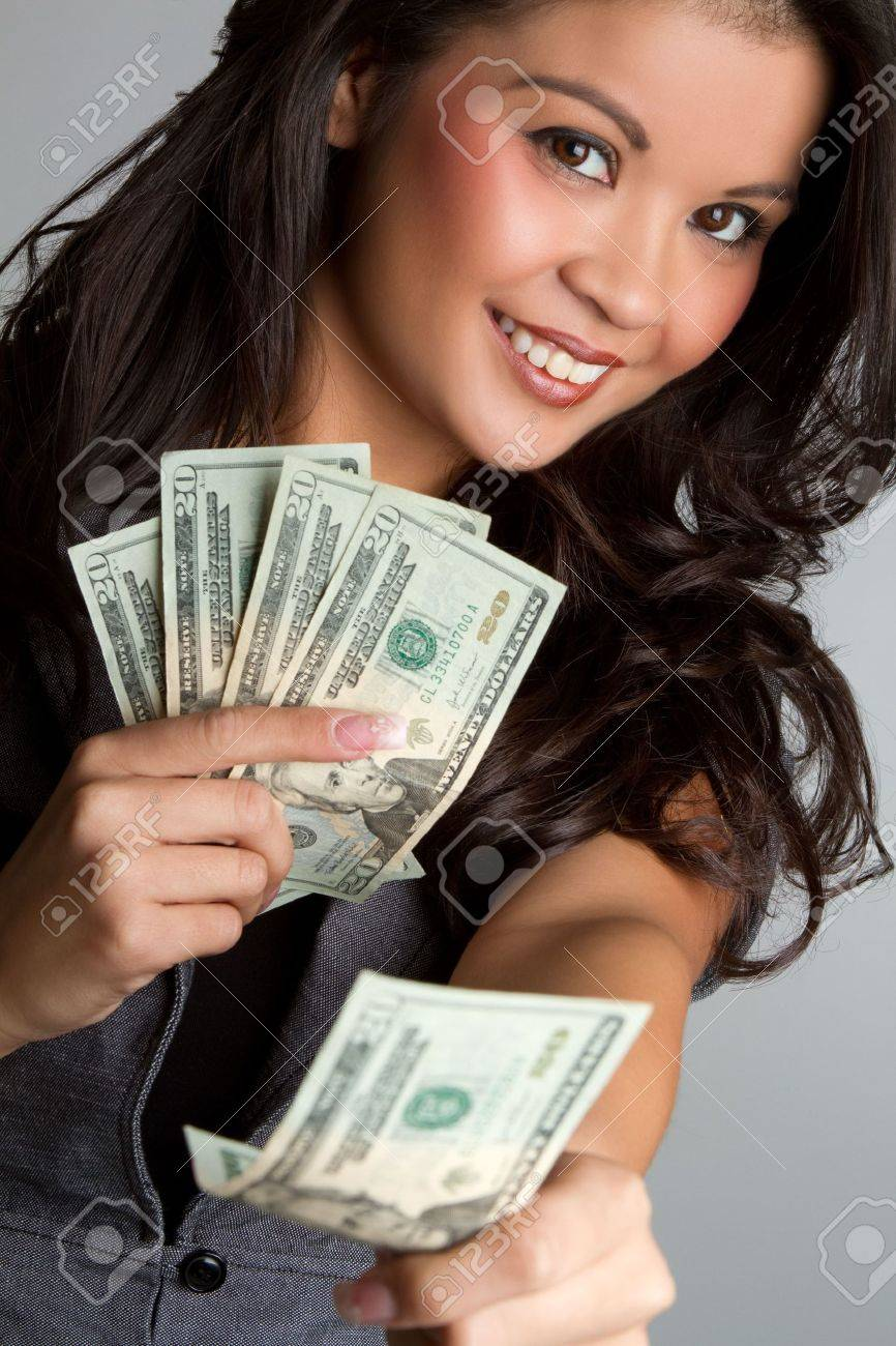 Smiling woman holding money - 7007440