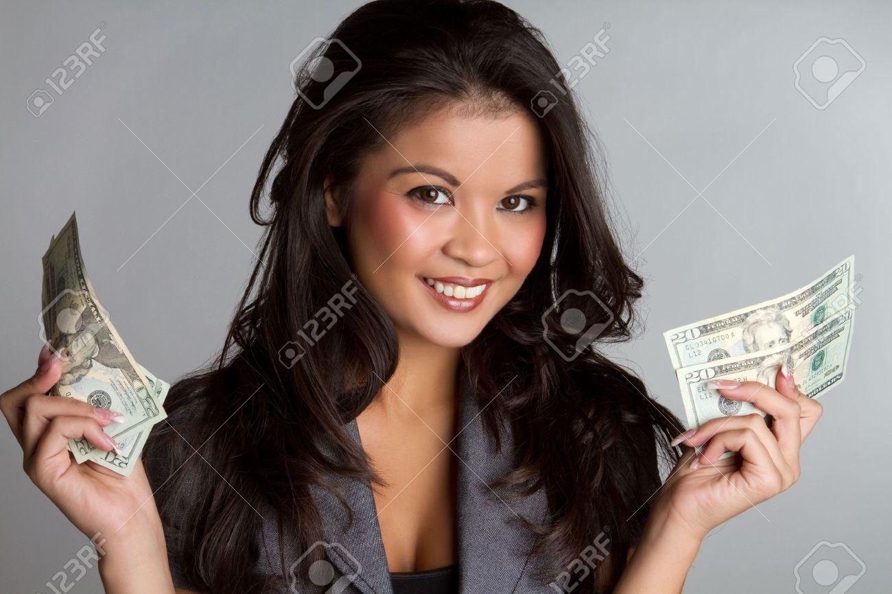 Beautiful smiling business woman holding money Stock Photo - 7076961