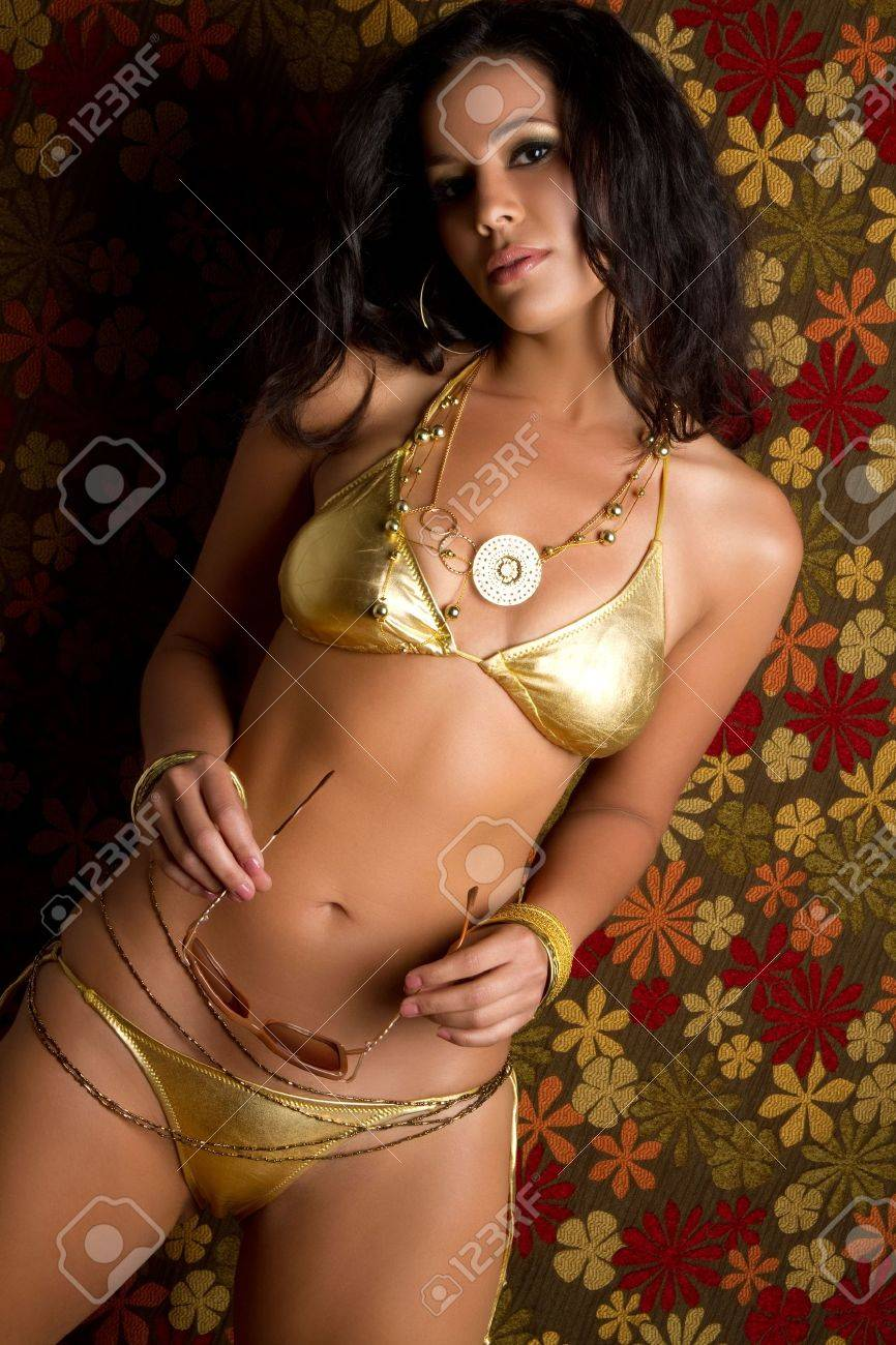 Sexy woman wearing gold bathing suit Stock Photo - 7148572