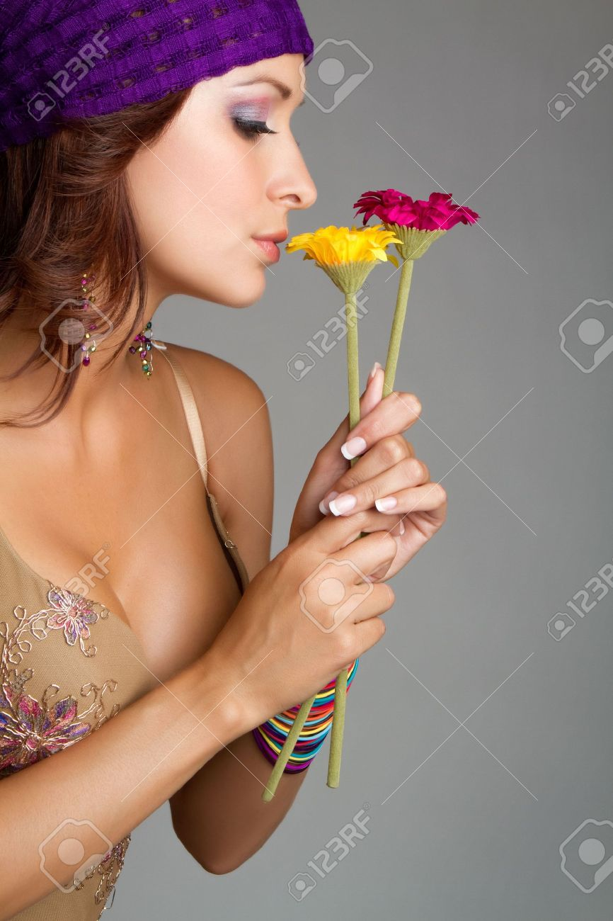 Woman smelling flowers Stock Photo - 7206450