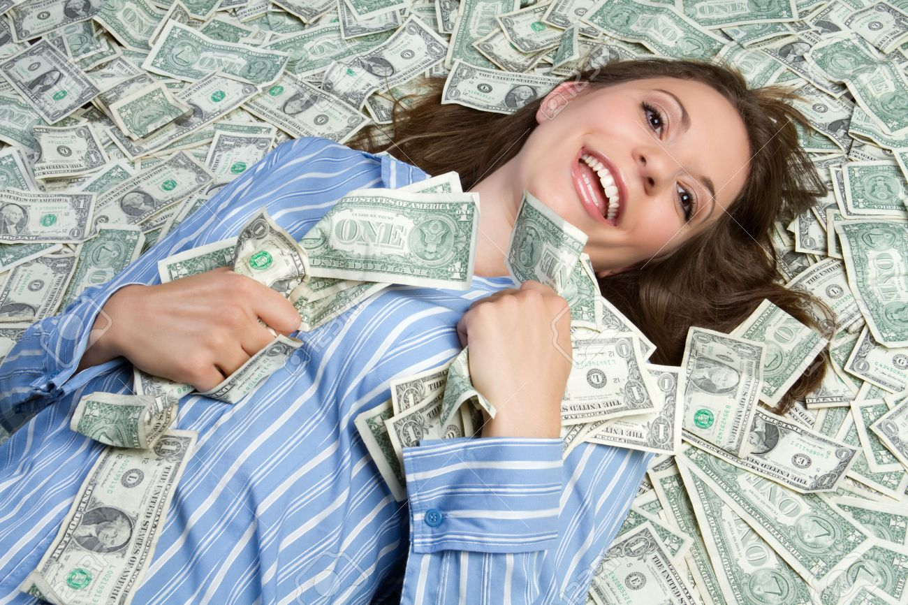 Woman laying in money - 8052781