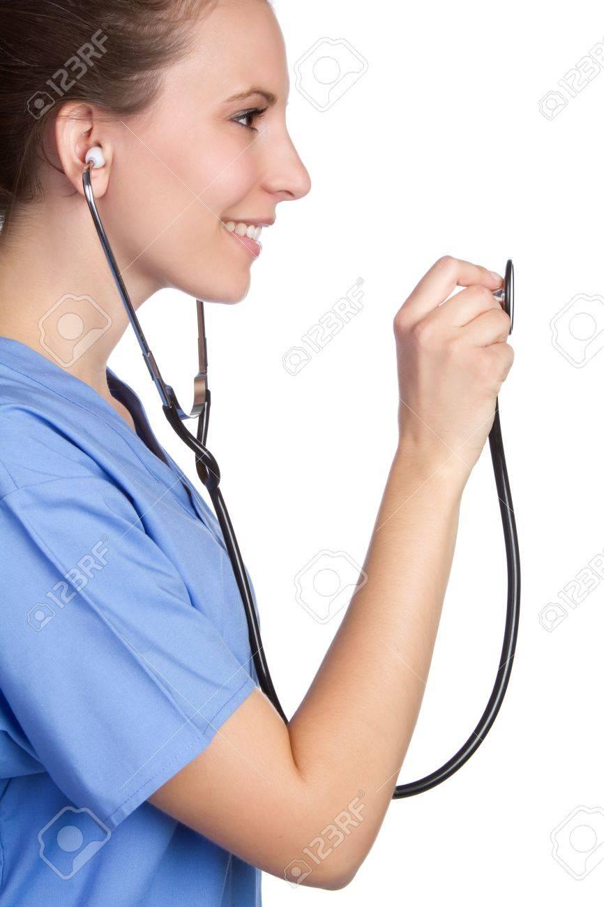 Smiling nurse holding stethoscope - 9105764