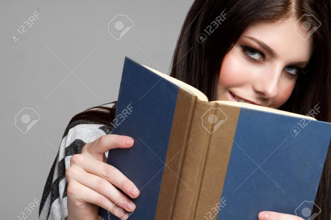 Pretty teen girl reading book Stock Photo - 9084263