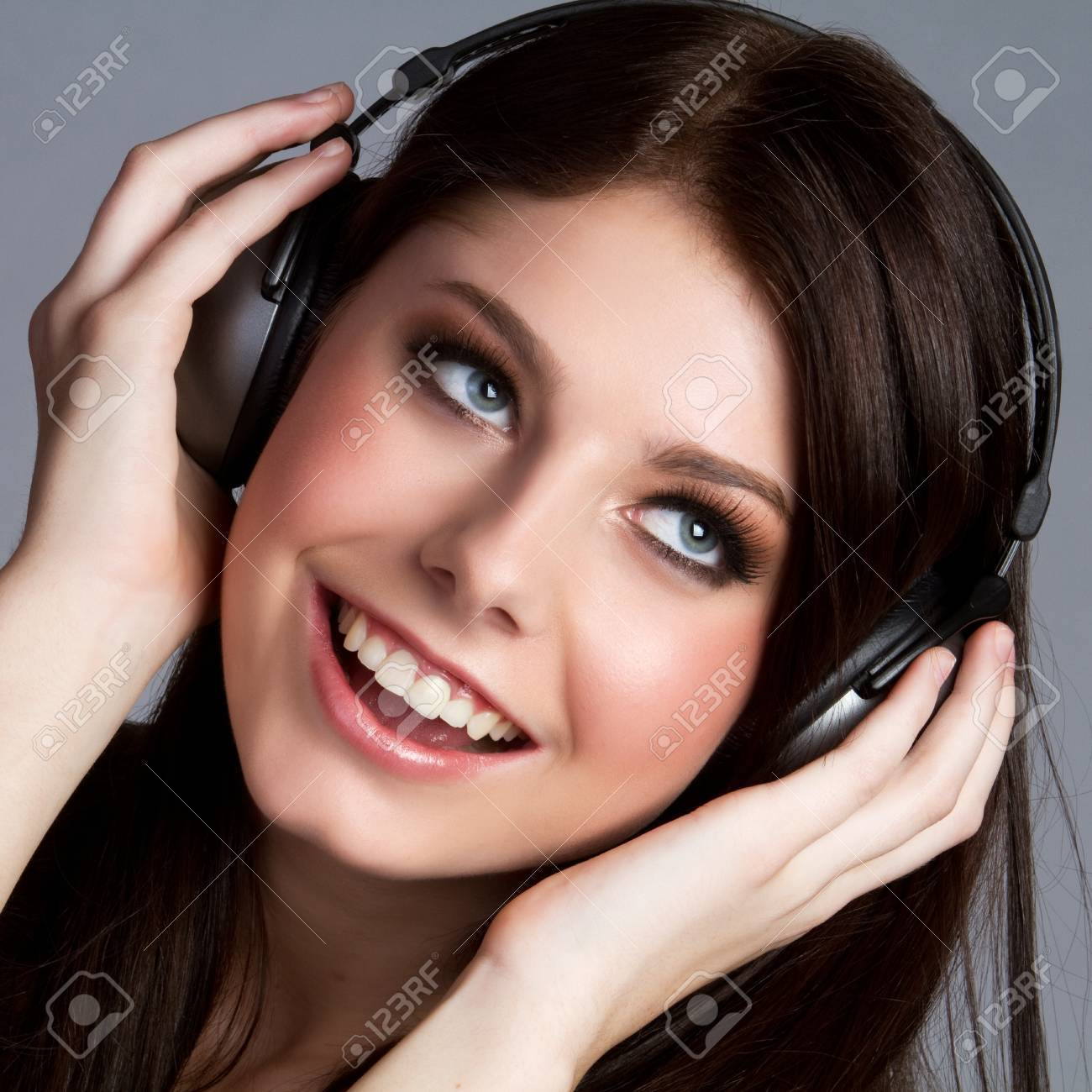 Girl listening to music through a headphone. Stock Photo - 9084252