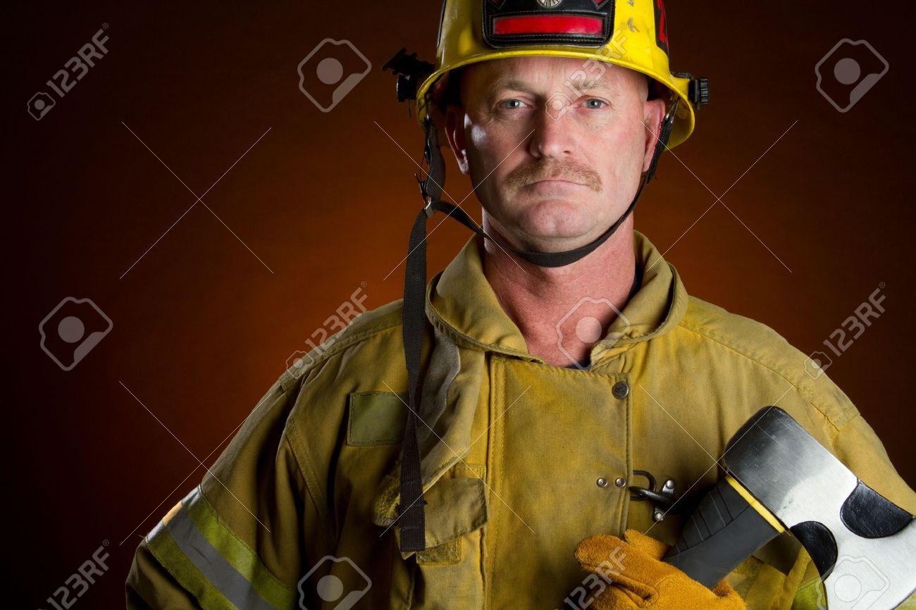 Firefighter fireman man holding axe - 10435418