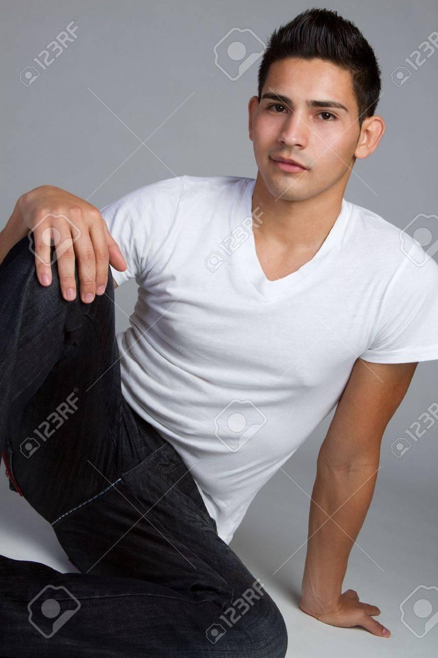 Young hispanic man sitting Stock Photo - 11215874