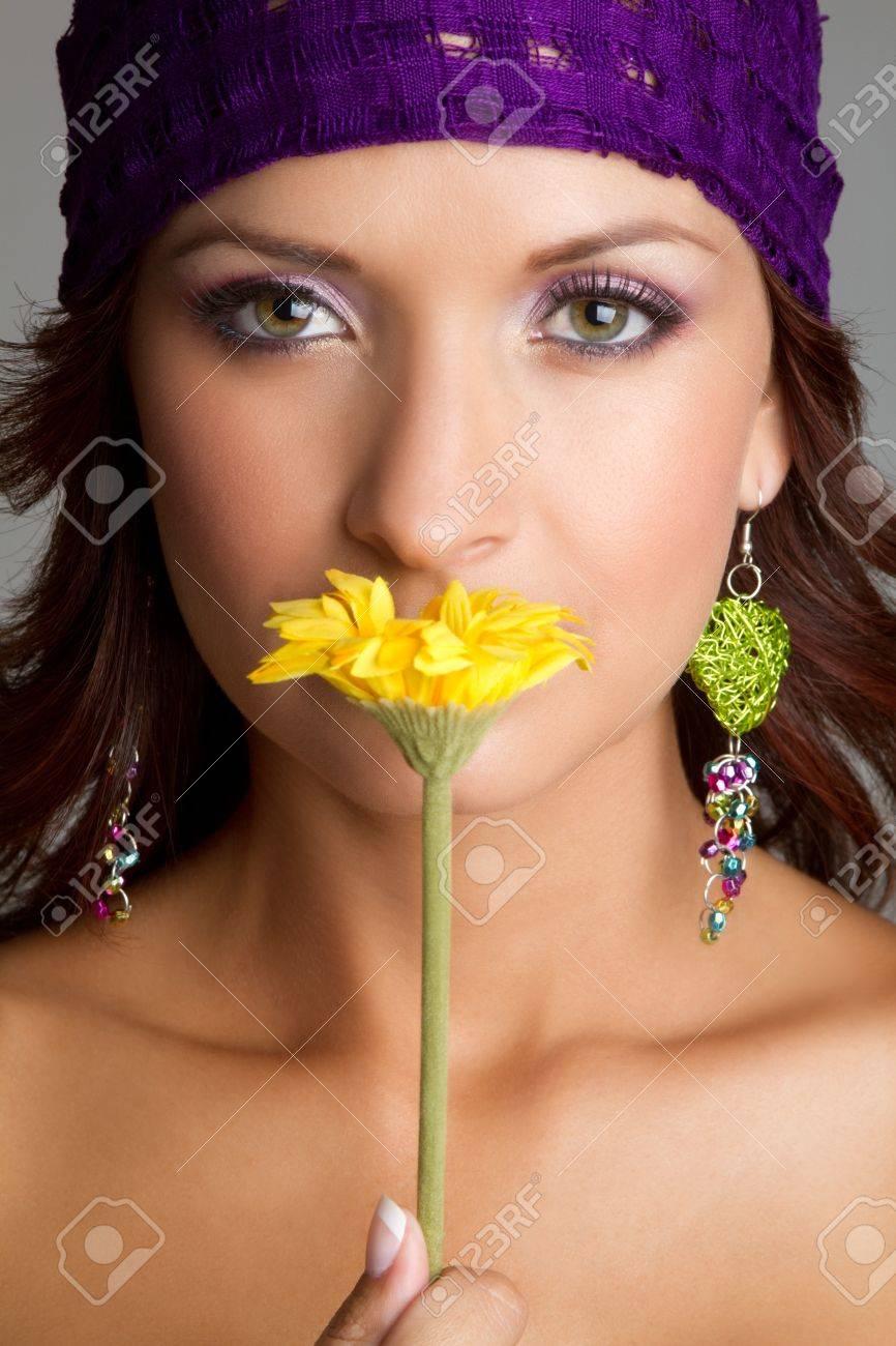 Beautiful woman smelling yellow flower Stock Photo - 11215887