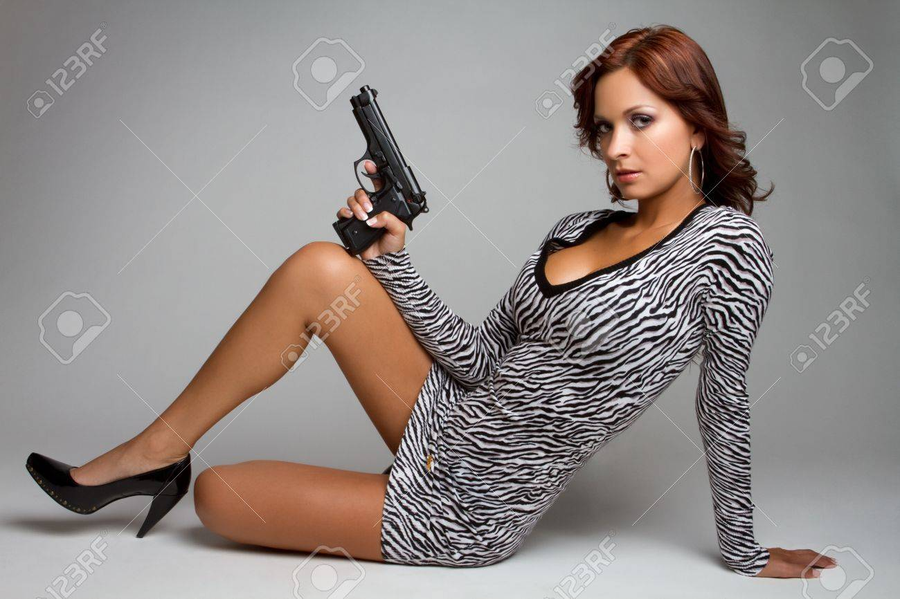 Sexy latin woman holding gun Stock Photo - 11215896