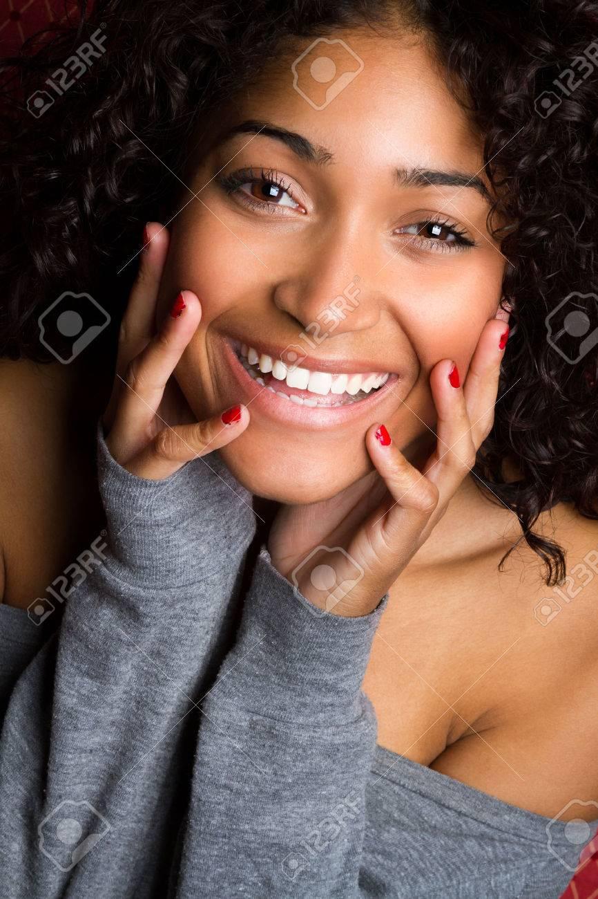 Beautiful smiling black woman closeup - 43183616