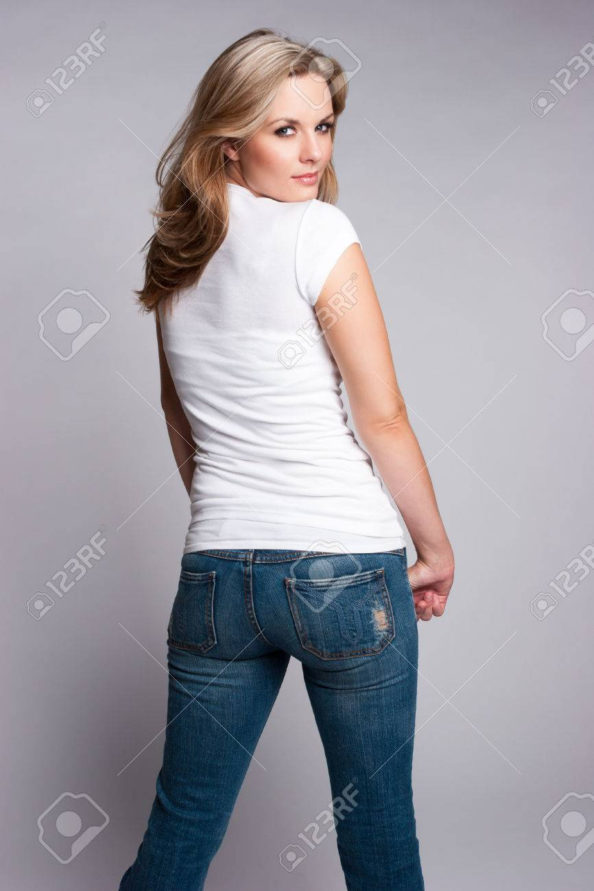 0aca3f15fe8 Beautiful blond woman wearing jeans and white tshirt Stock Photo - 46045733