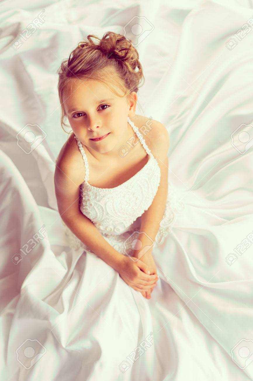 Pretty Little Girl Wearing Wedding Dress Stock Photo, Picture And ...