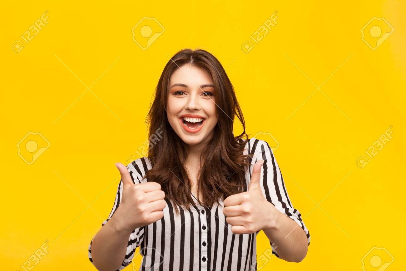 Delighted woman posing with thumbs up - 79280722