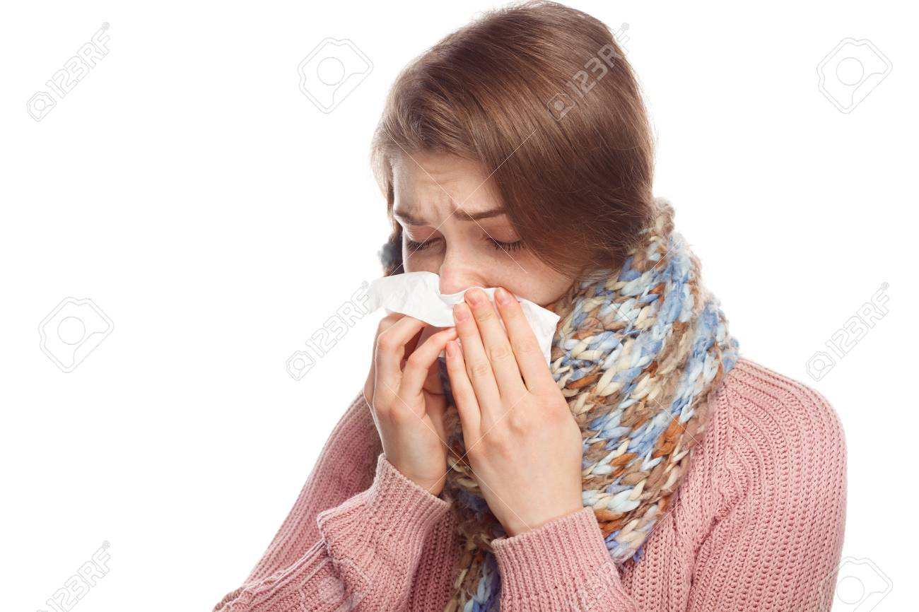Woman blowing her nose - 81578672
