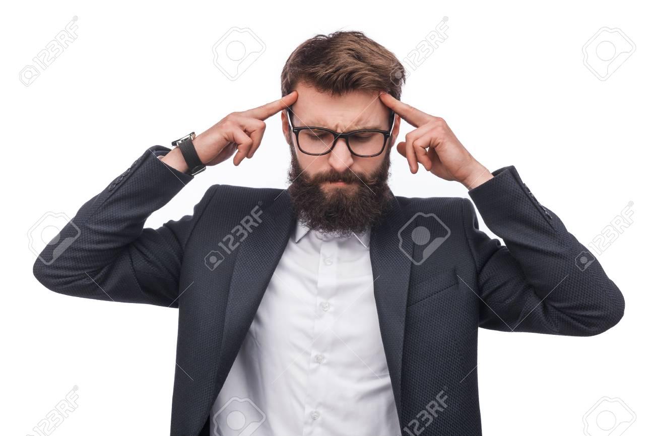 Pensive businessman concentrating on mind - 100062834