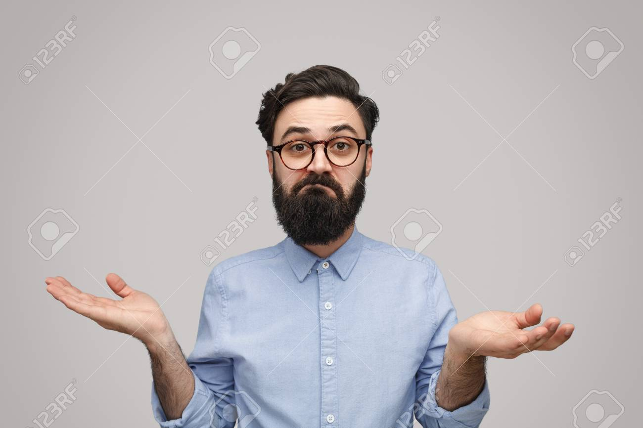Doubtful bearded man shrugging with shoulders - 115930528