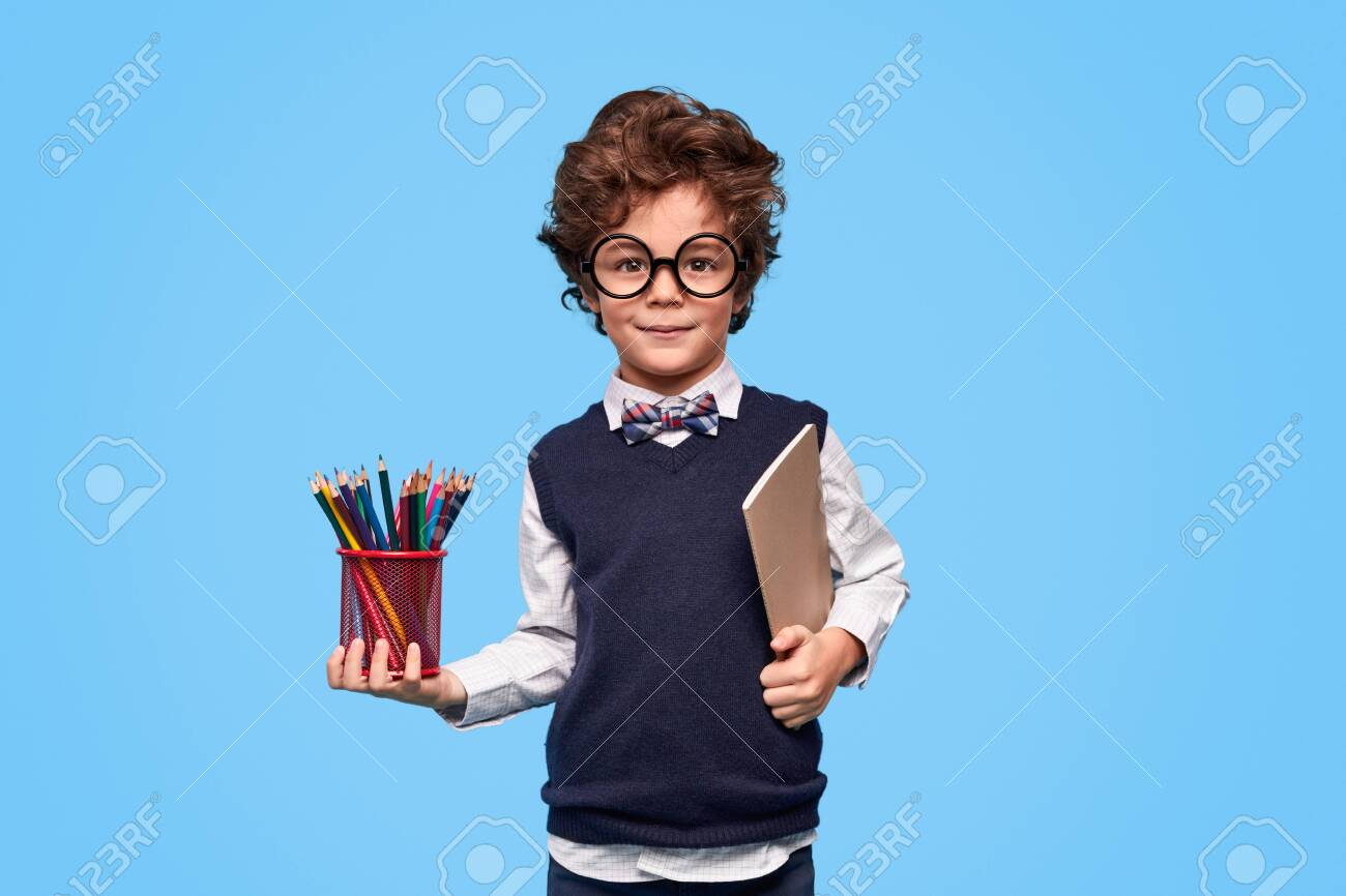 Clever schoolboy with stationery - 129623737