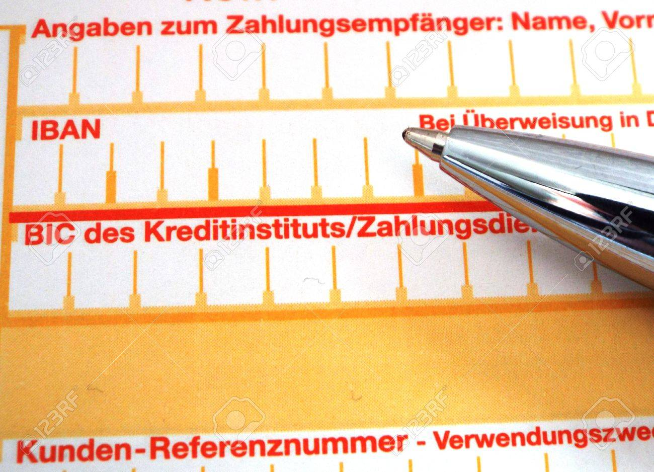 IBAN - Close-up of the IBAN and BIC fields of a transaction form, along with the tip of a pen. - 38281172
