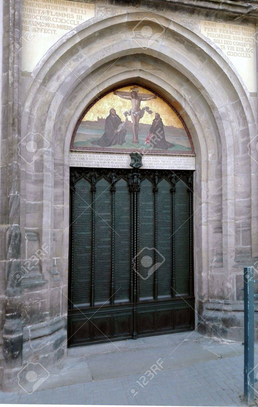 Wittenberg: Luther City - Tower of the Castle Church of All Saints, Wittenberg, Germany 04.12.2016 At the door of the Castle Church in Wittenberg reformer Martin Luther nailed his 95 theses. By Luther and Melanchthon, the Wittenberg wurde the center of th - 58566428