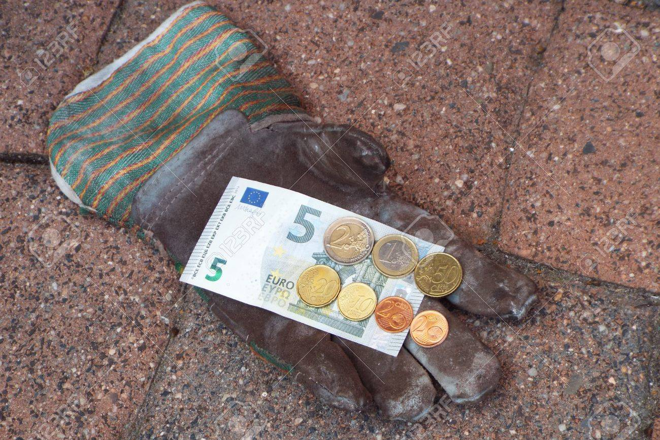 Germany minimum wage increase - On a work glove are ?,? 8.84, the German minimum wage from 2017th. - 60581392