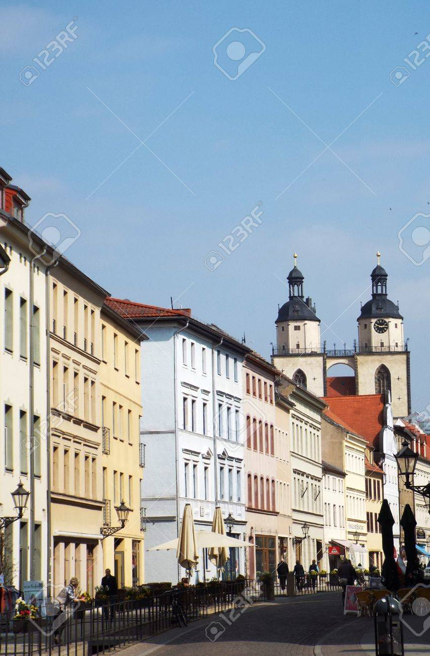 Towers of St. Mary's Church. View from the Castle Street. Wittenberg, Germany 04.12.2016 - At the door of the Castle Church in Wittenberg reformer Martin Luther nailed his 95 theses. By Luther and Melanchthon, the Wittenberg wurde the center of the Reform - 69414722