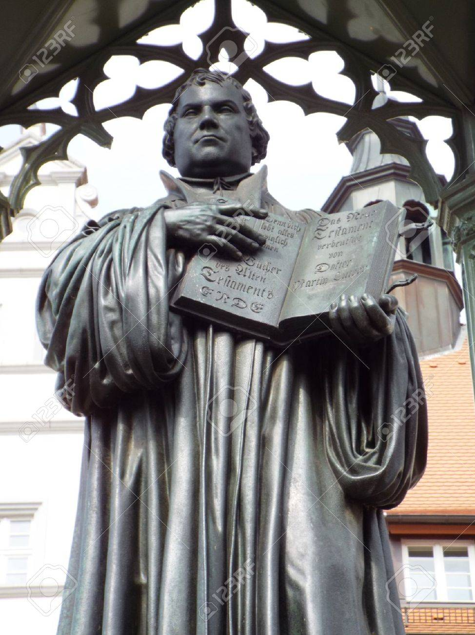 Monument Luther on the Market Place in front of the townhall, Wittenberg, Germany 04.12.2016 - At the door of the Castle Church in Wittenberg reformer Martin Luther nailed his 95 theses. By Luther and Melanchthon, the Wittenberg wurde the center of the Re - 69414725