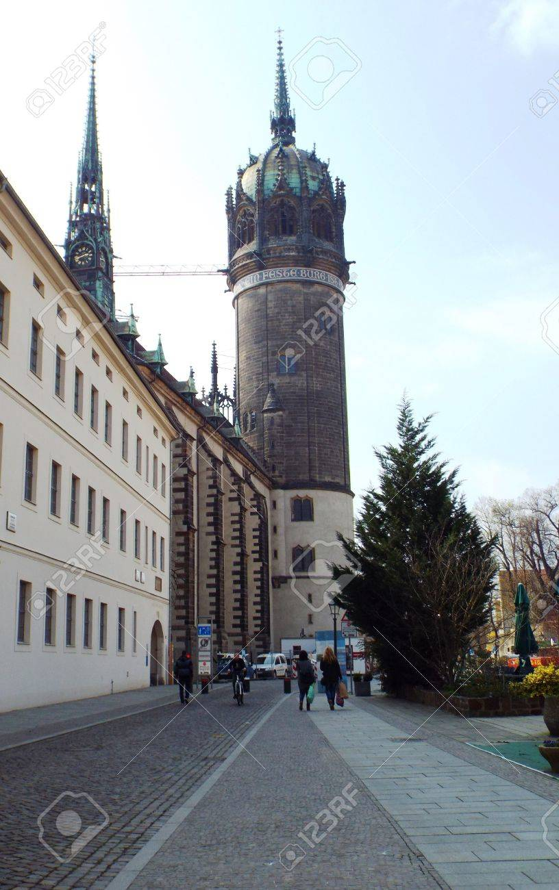 Tower of the Castle Church of All Saints, Wittenberg, Germany 04.12.2016 - At the door of the Castle Church in Wittenberg reformer Martin Luther nailed his 95 theses. By Luther and Melanchthon, the Wittenberg wurde the center of the Reformation. - 69414730