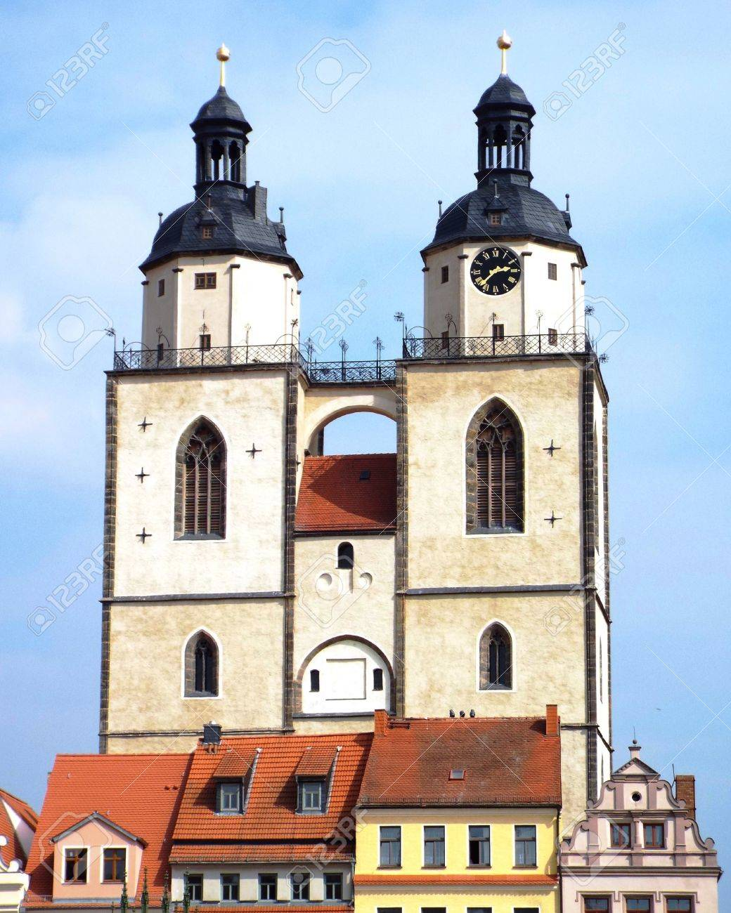 Towers of St. Mary's Church, Wittenberg, Germany 04.12.2016 - At the door of the Castle Church in Wittenberg reformer Martin Luther nailed his 95 theses. By Luther and Melanchthon, the Wittenberg wurde the center of the Reformation. - 69414851