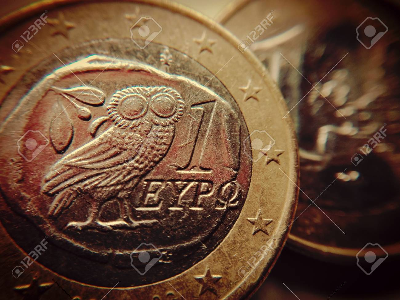 The owl of wisdom on a one euro coin - A Greek euro coin with the Athenian owl, - 83011894
