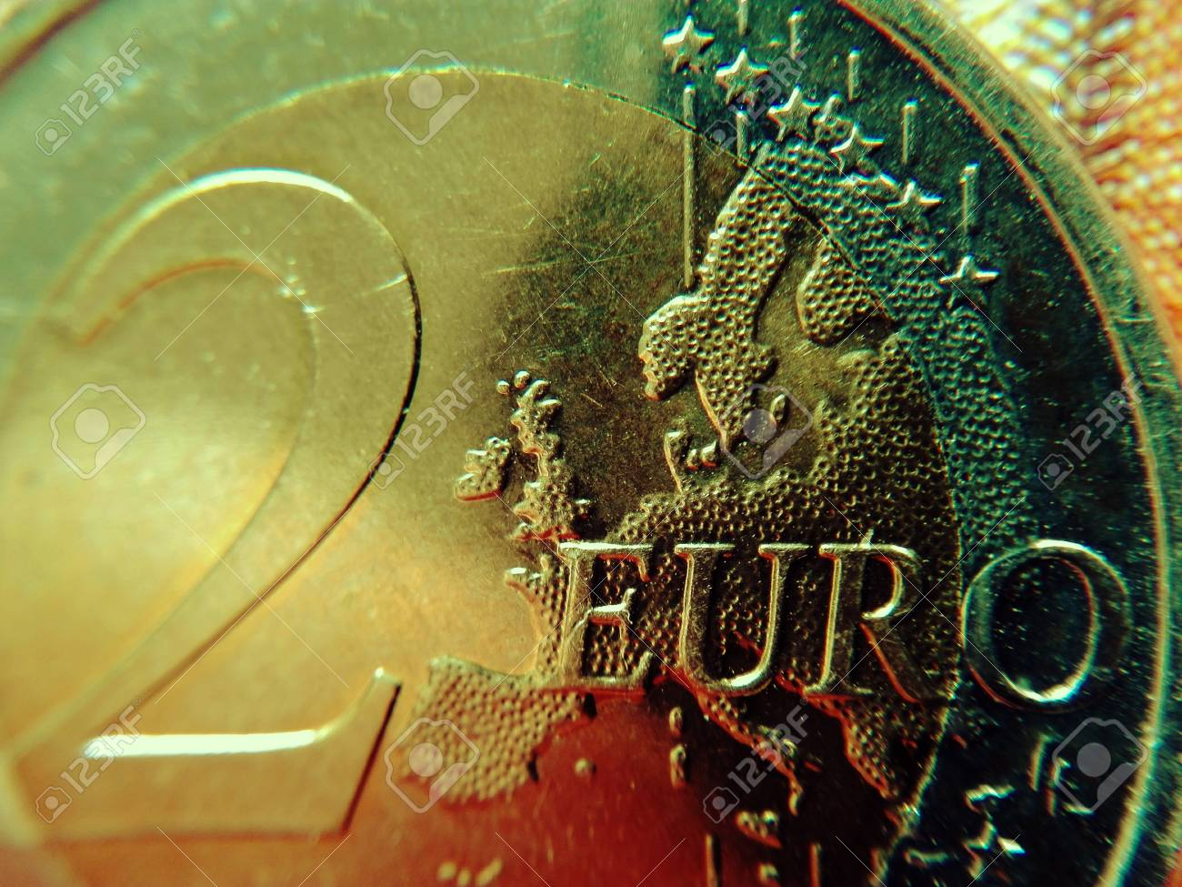 Europe on the two-euro coin - The euro card of a euro coin as a cut-out. - 82983122