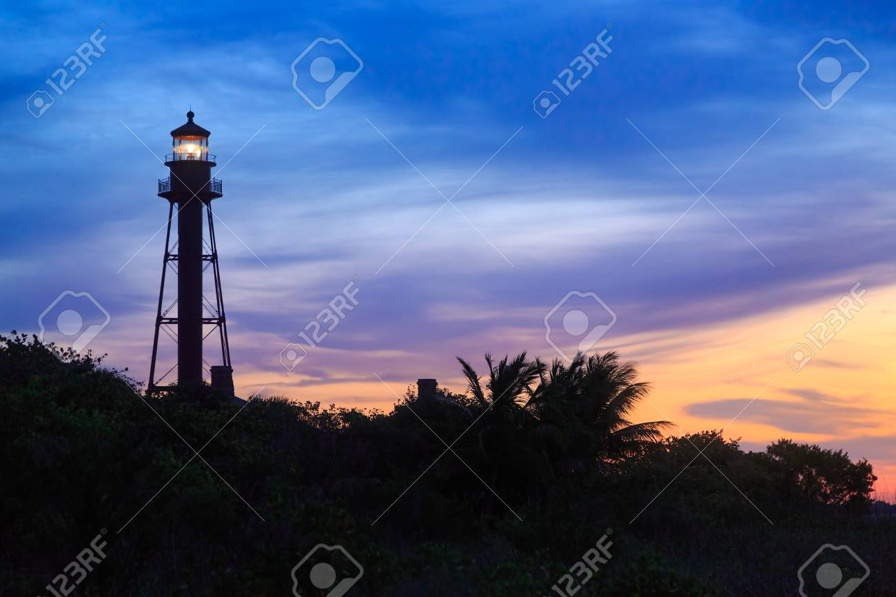Stock Photo   The Sanibel Island Light, A Florida Lighthouse, Is  Silhouetted By A Colorful Sunrise Sky.