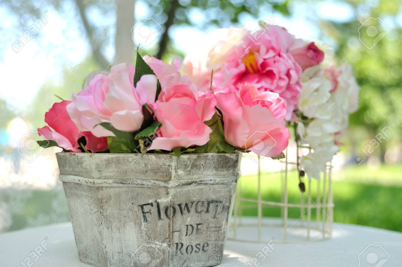 Bouquet Of Beautiful Artificial Flowers Wooden Basket On Table Stock
