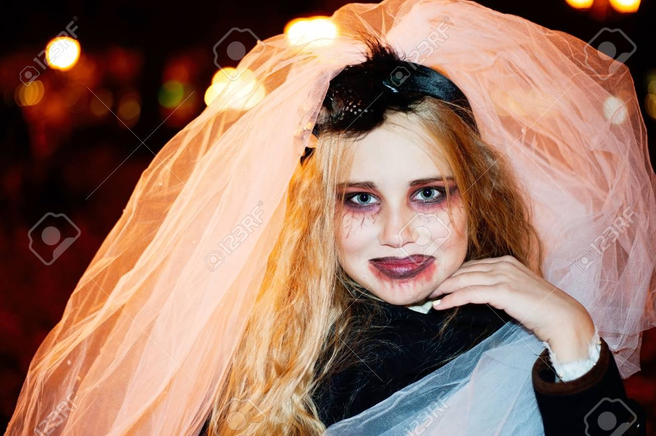 girl teenager in the image of a dead bride zombie on halloween closeup portrait stock photo