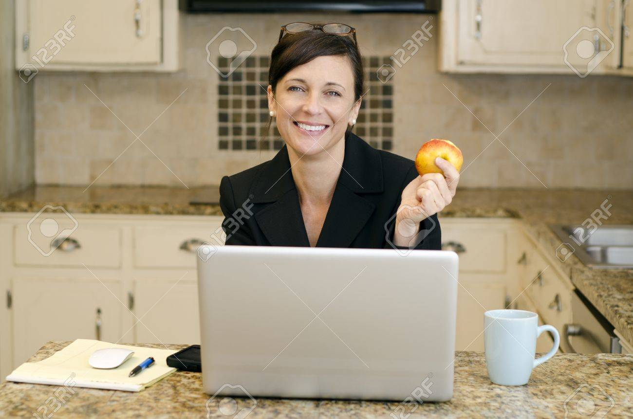 makeshift office. working mom with makeshift office set up in th ekitchen stock photo 11976437