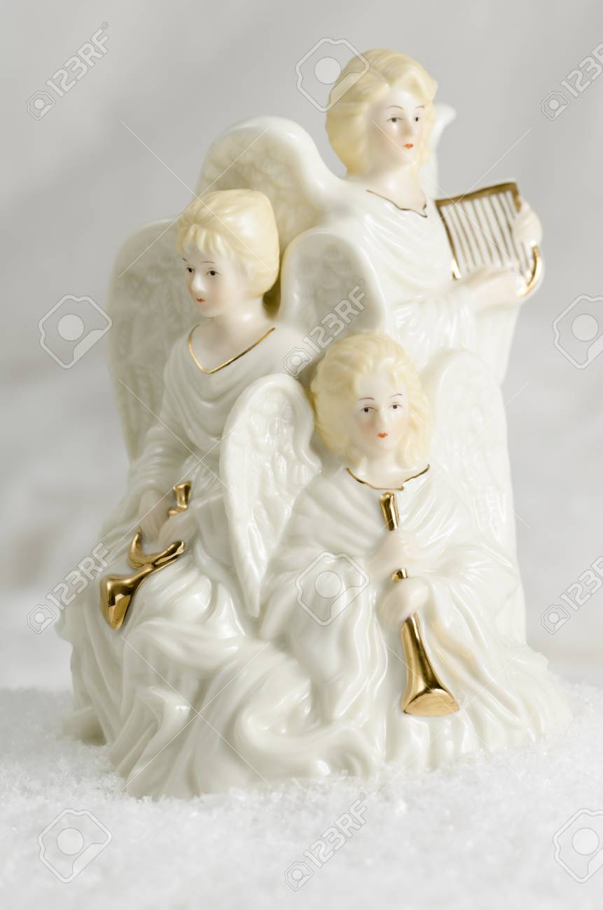 Three Ceramic Christmas Angels And Their Onstruments Stock Photo ...