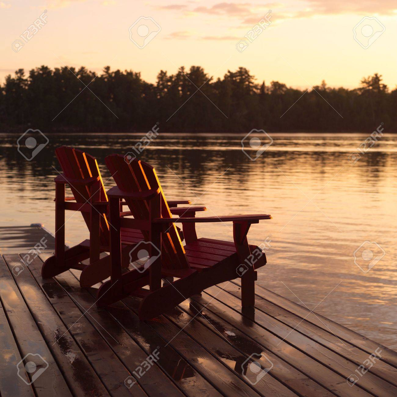 Lake Of The Woods Ontario Canada,Empty Chairs On Dock Stock Photo   2345867