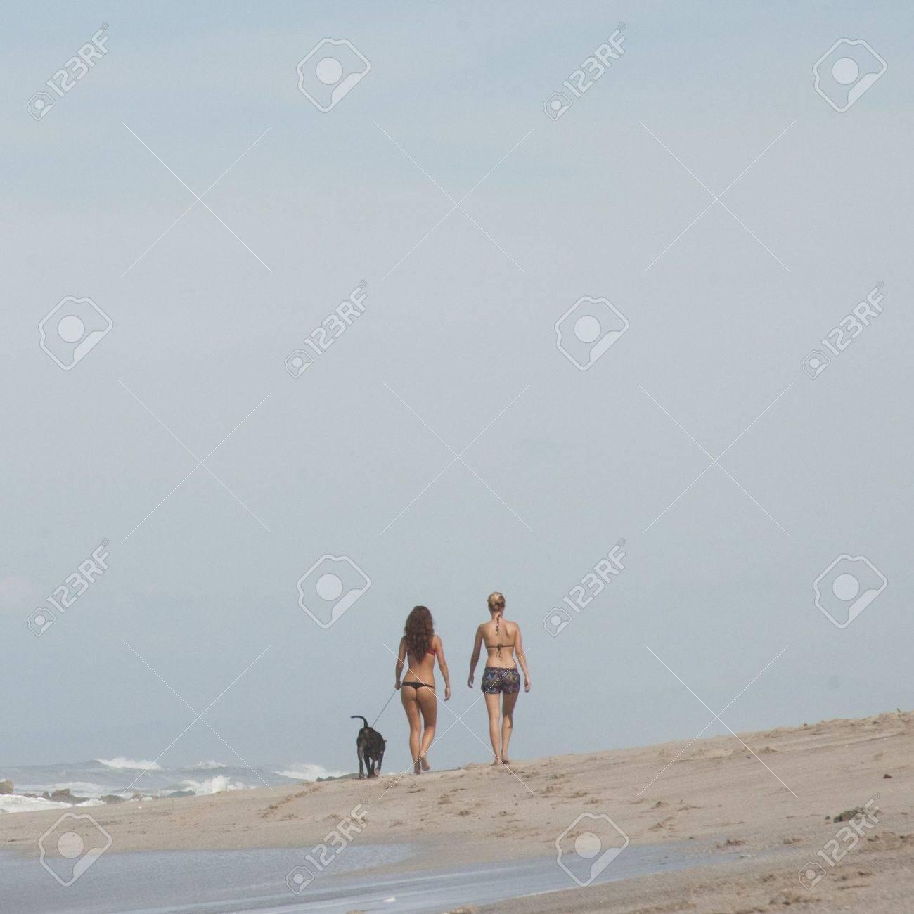 Two women walking on the beach in Costa Rica Stock Photo - 9259789