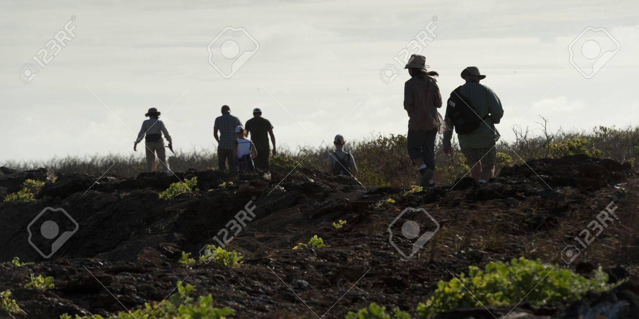 Hikers on a hill, Prince Philip's Steps, Tower Island, Darwin Bay, Genovesa Island, Galapagos Islands, Ecuador Stock Photo - 16708882
