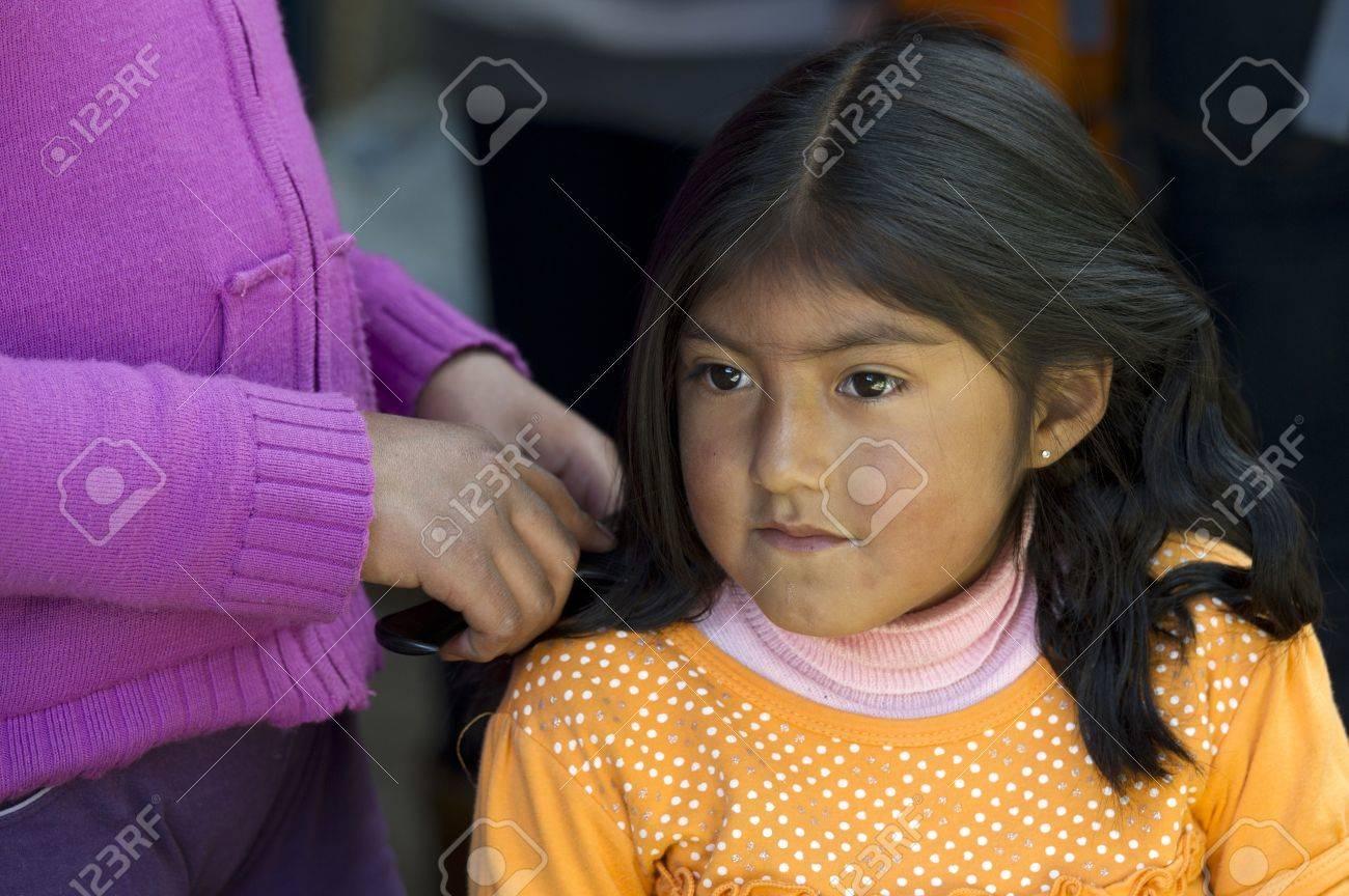 Woman combing her daughter's hair, Barrio de San Blas, Cuzco, Peru Stock Photo - 17227880
