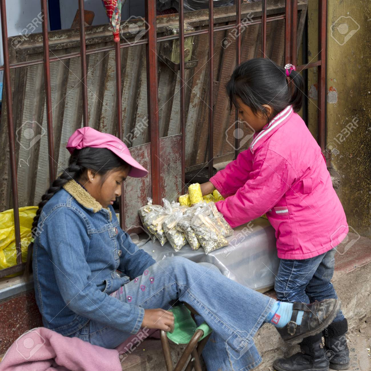 Two girls at a market stall, Sacred Valley, Cusco Region, Peru Stock Photo - 17227892