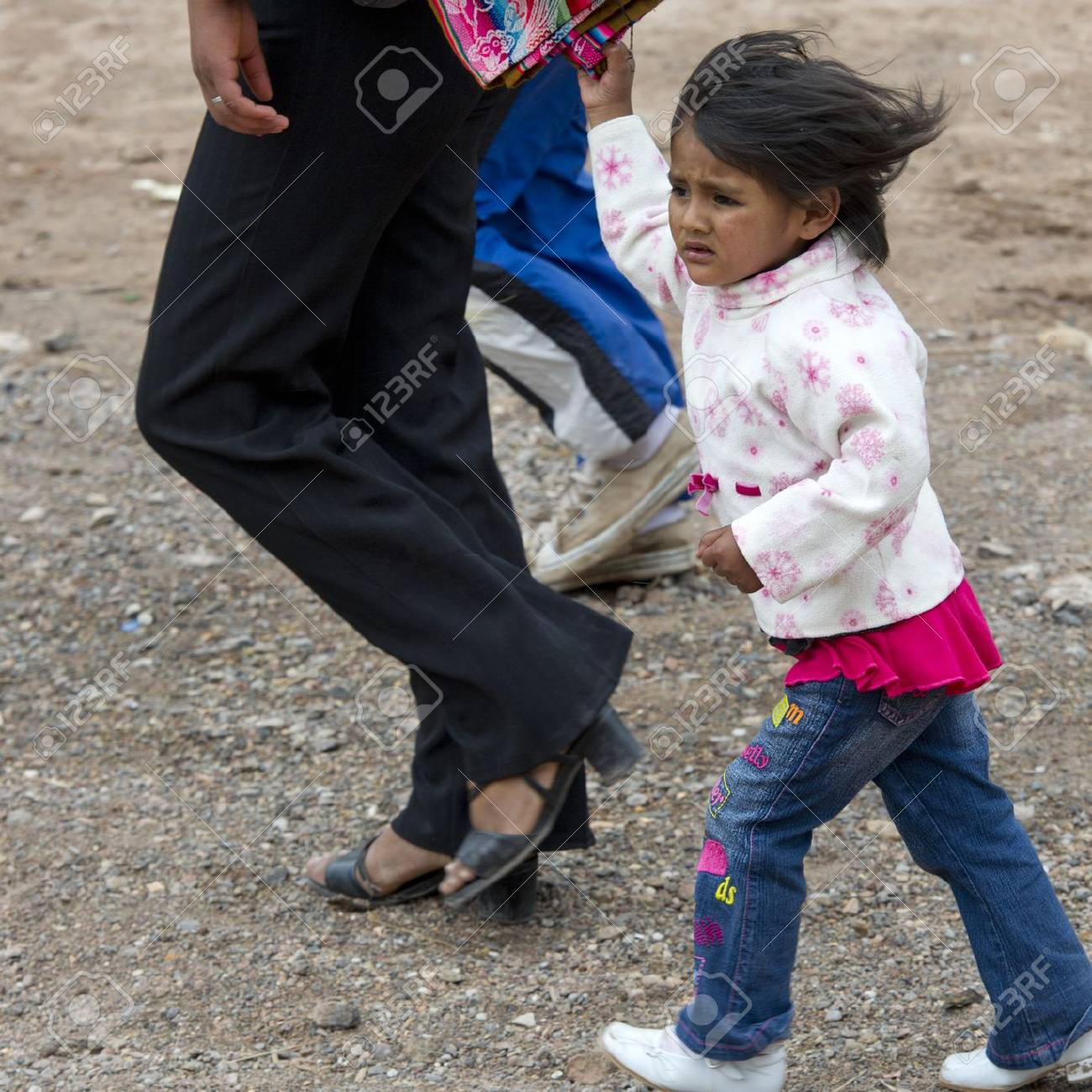Girl walking with her parents, Sacred Valley, Cusco Region, Peru Stock Photo - 17227816