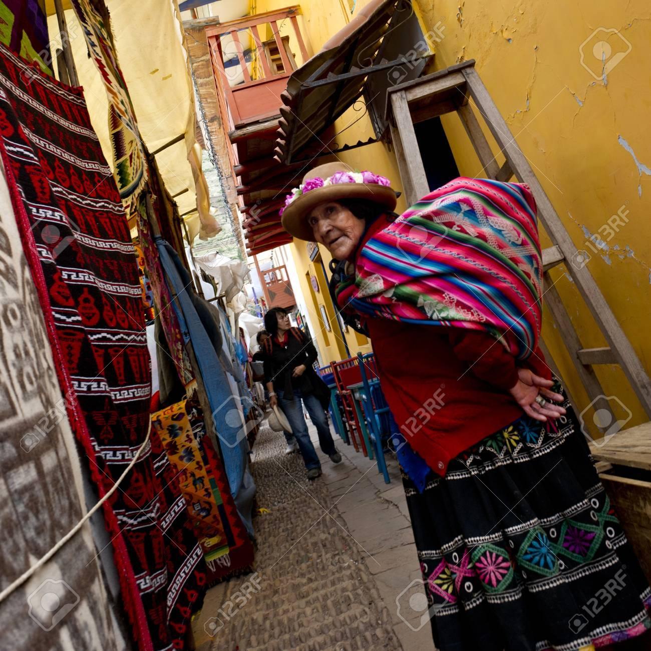 Woman standing at Sunday market, Pisac, Cuzco, Peru Stock Photo - 17227882