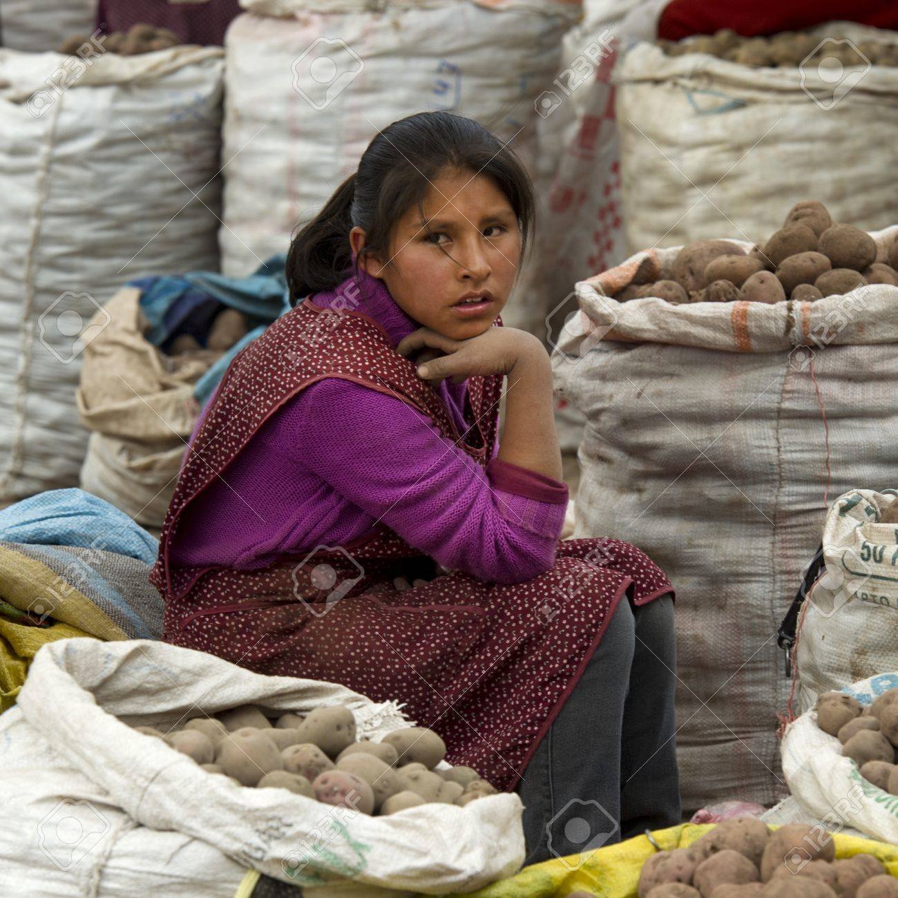 Teenage girl selling potatoes at Sunday market, Pisac, Cuzco, Peru Stock Photo - 17227806