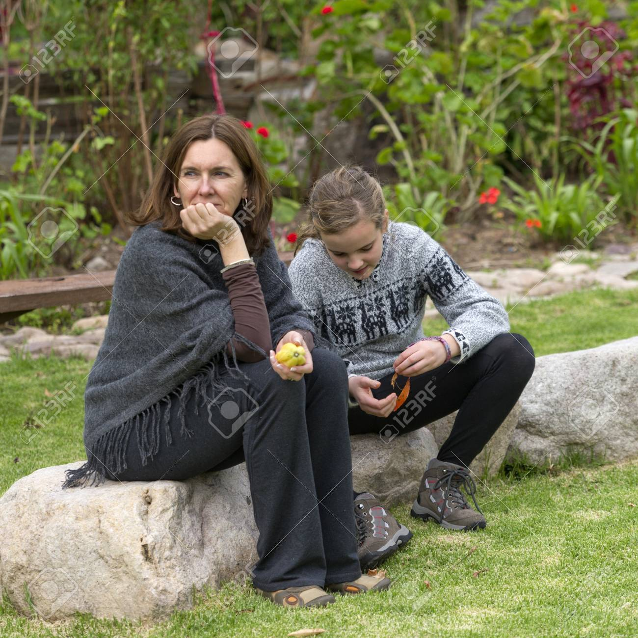 Woman with her daughter sitting in the lawn of Willka Tika Guesthouse, Willka Tika, Sacred Valley, Cusco Region, Peru Stock Photo - 17227904