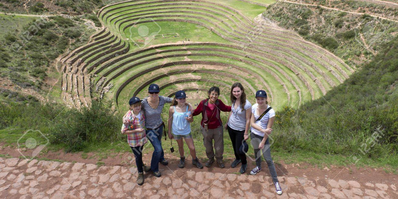 High angle view of people with Incan agricultural terraces in the background, Moray, Machu Picchu, Cusco Region, Peru Stock Photo - 17227931