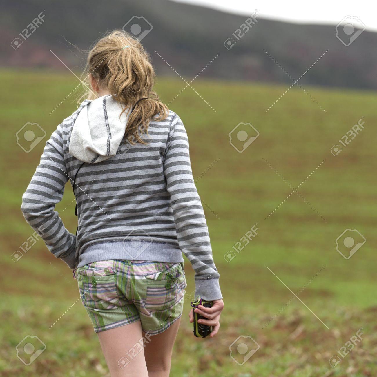 Teenage girl walking in a field, Sacred Valley, Cusco Region, Peru Stock Photo - 16793228